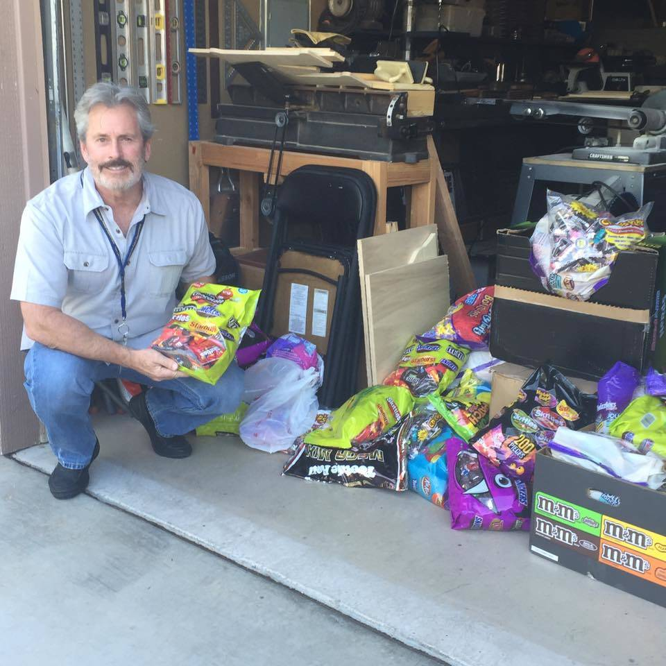Jeff Crampton, president of the Friends of the Henderson Police Department Foundation, is seen next to bags of candy, which Crampton collected for the Henderson Police Department's annual Trunk or ...