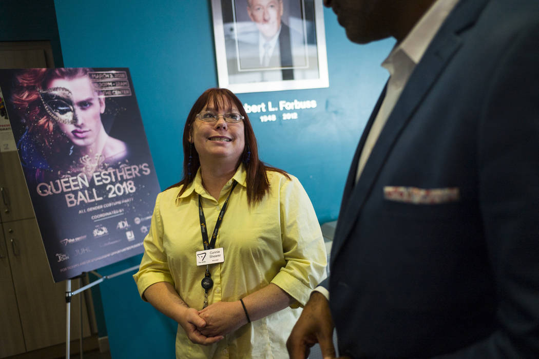 Volunteer Connie Shearer talks with Andre Wade, executive director of The Center, also known as the Gay and Lesbian Community Center of Southern Nevada, in Las Vegas on Thursday, Feb. 22, 2018. Ch ...
