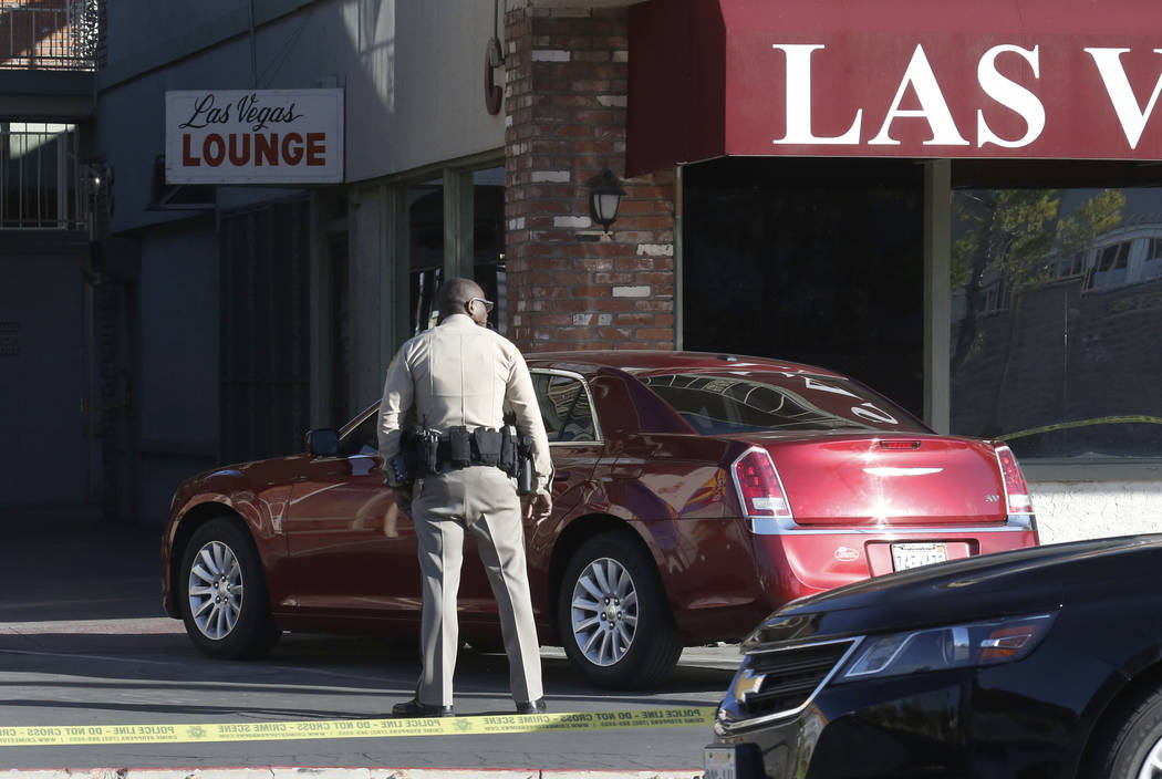 Las Vegas police investigate a shooting at the Las Vegas Lounge, 900 E. Karen Ave on Friday, Feb. 23, 2018, in Las Vegas. Bizuayehu Tesfaye/Las Vegas Review-Journal @bizutesfaye