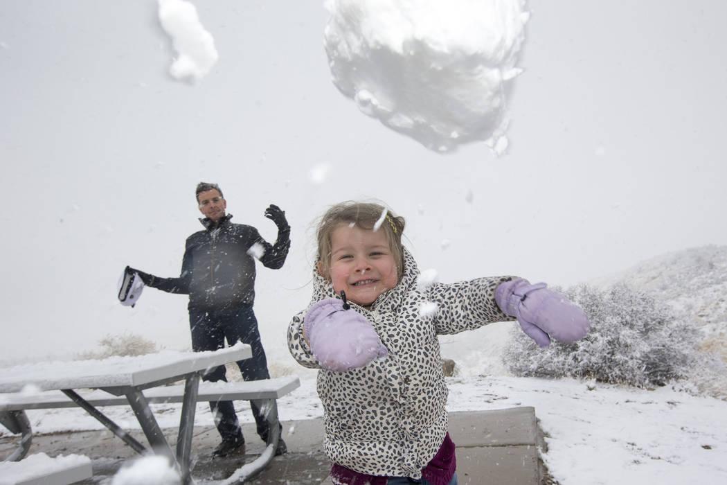 Danny Vasquez of Las Vegas and his daughter Nika, 4, throw snowballs at Red Rock Canyon Overlook, Friday, Feb. 23, 2018 near Las Vegas. Richard Brian Las Vegas Review-Journal @vegasphotograph
