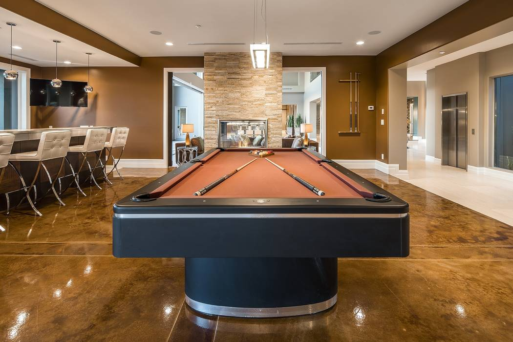 Among its amenities, the residence features a billiards room.  (Shapiro & Sher Group)