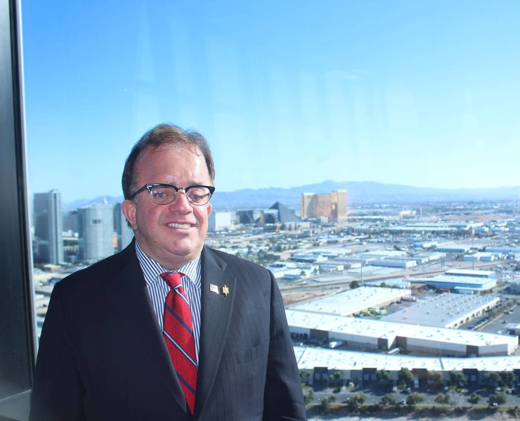 Jeffrey Meehan Special to RJRealEstate.Vegas Christopher McGarey, team leader of McGarey Group at Berkshire Hathaway Home Services, Nevada Properties, stands at the top of the Palm Casino's Fantas ...