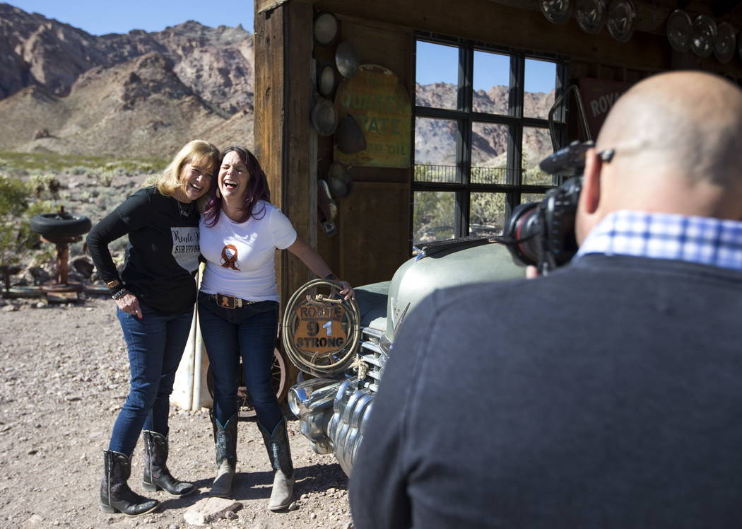 Route 91 Harvest survivors Tracy Pirtle, left, and her daughter, Kacey Martino, of Logandale, Nev., share a laugh as they pose during a photoshoot for Route 91 survivors at the Eldorado Canyon Min ...