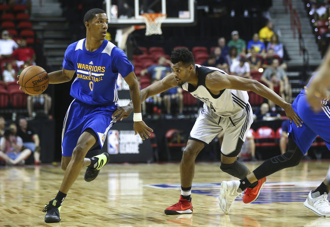 Golden State Warriors' Patrick McCaw (0) drives against Minnesota Timberwolves' Charles Cooke (44) during a basketball game at the NBA Summer League at the Thomas & Mack Center in Las Vegas on ...