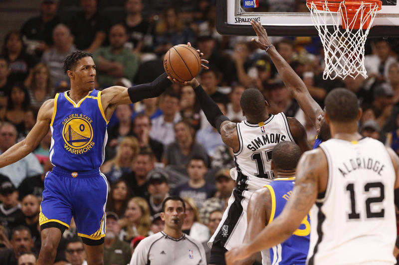 May 22, 2017; San Antonio, TX, USA; Golden State Warriors point guard Patrick McCaw (0) blocks a shot attempt by San Antonio Spurs shooting guard Jonathon Simmons (17) during the second half in ga ...