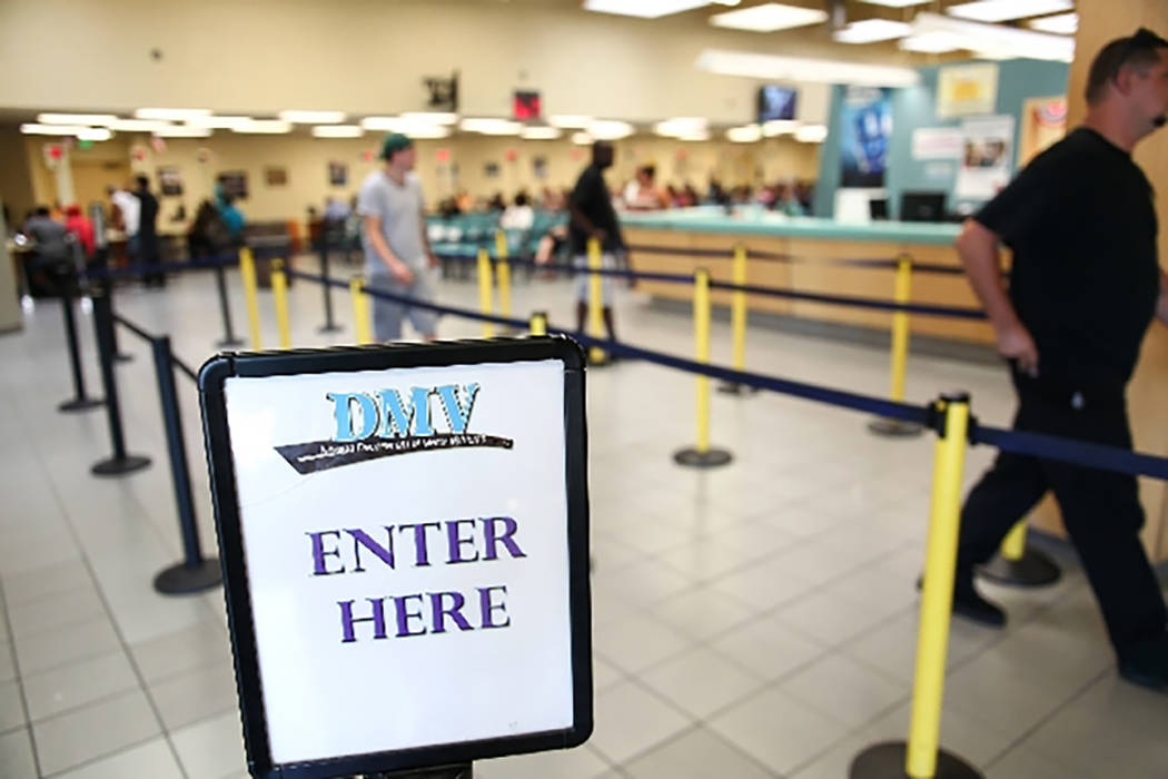 People walk through the line at the DMV office at 2701 E. Sahara Ave. in Las Vegas. (Las Vegas Review-Journal)