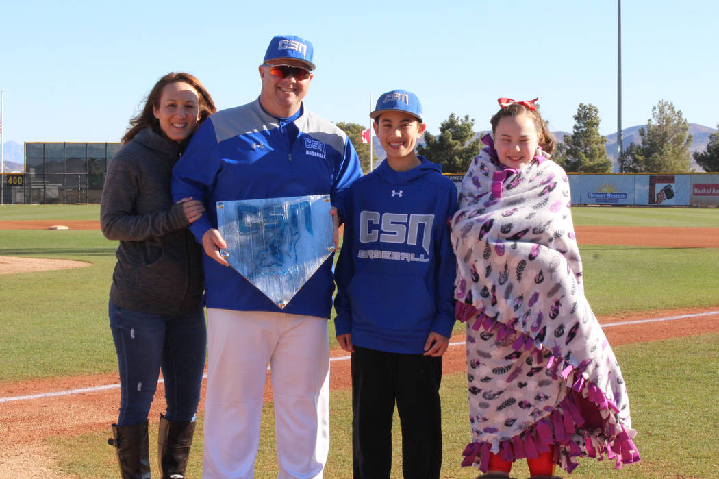 College of Southern Nevada baseball coach Nick Garritano celebrates his 600th coaching victory with his family at Morse Stadium in Henderson. From l to r: Wife Camille, Garritano, son Nicky, daugh ...