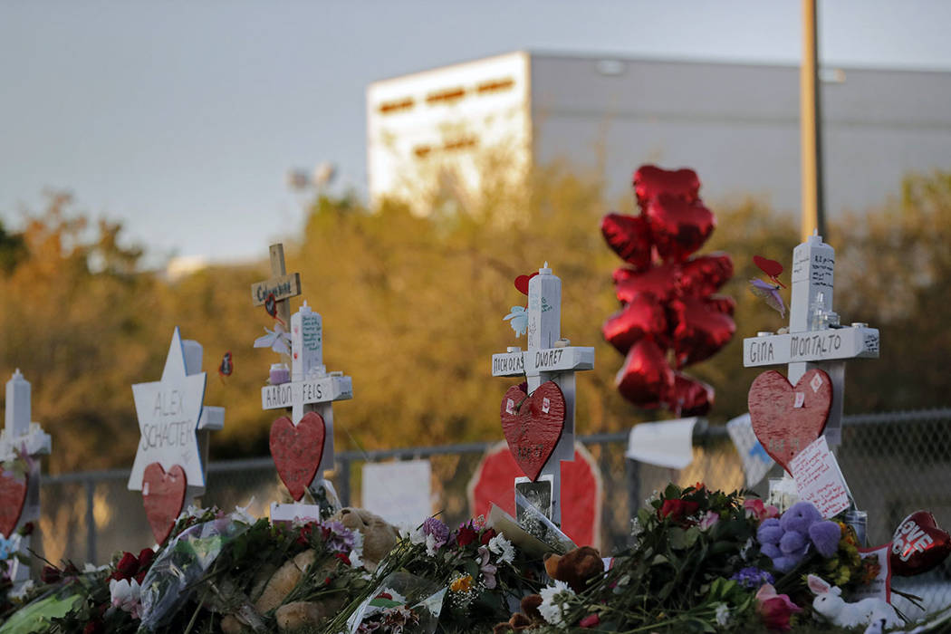 A makeshift memorial is seen outside the Marjory Stoneman Douglas High School, where 17 students and faculty were killed in a mass shooting on Wednesday, in Parkland, Fla., Monday, Feb. 19, 2018.  ...