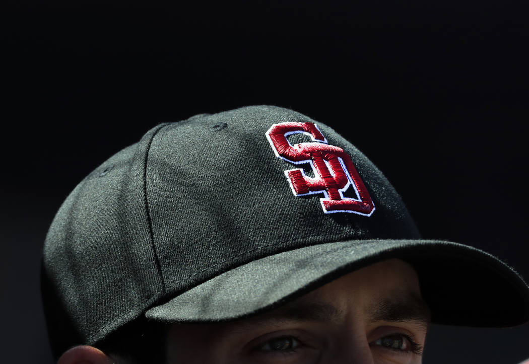 Washington Nationals pitcher Tim Collins wears the cap of the Marjory Stoneman Douglas High School Eagles baseball team before the start of an exhibition spring training baseball game against the  ...