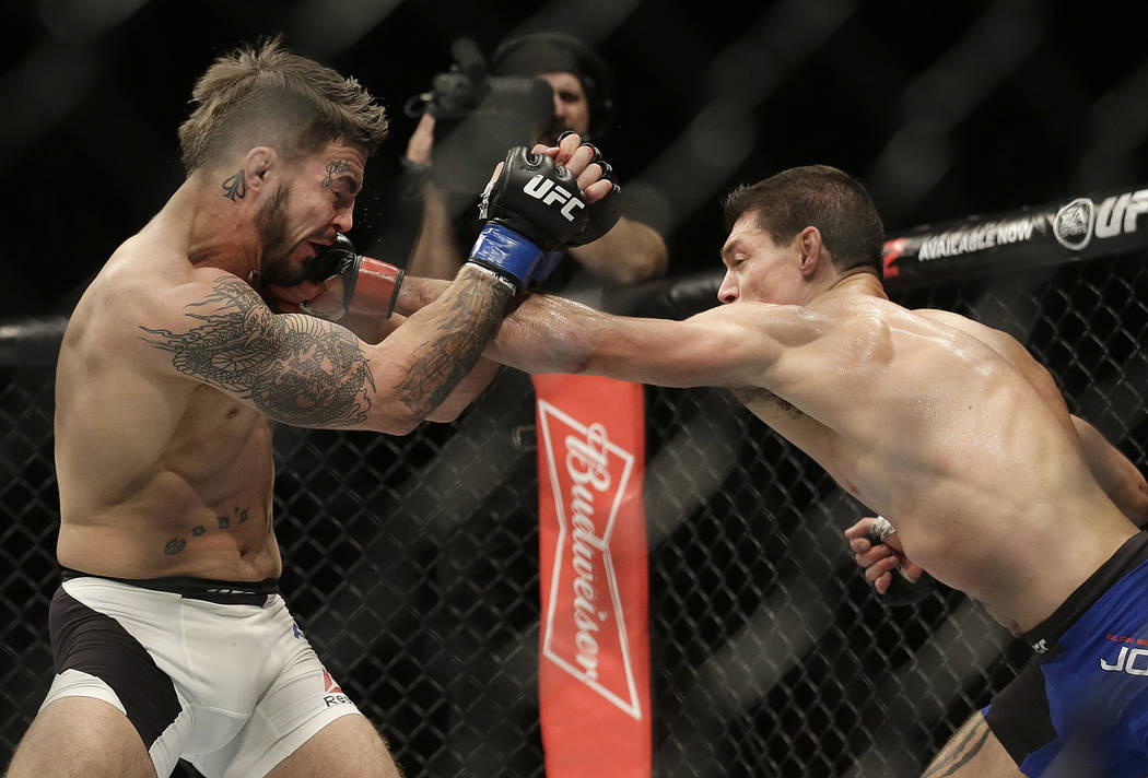 Alan Jouban, right, punches Mike Perry during the third round of a UFC Fight Night mixed martial arts bout in Sacramento, Calif., Saturday, Dec. 17, 2016. Jouban won by unanimous decision. (AP Pho ...