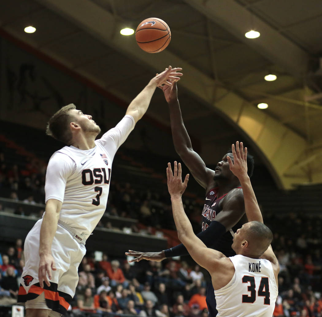 Arizona's Deandre Ayton shoots over Oregon State's Tres Tinkle (3) and Ben Kone (34) during the second half of an NCAA college basketball game in Corvallis, Ore., Thursday, Feb. 22, 2018. Arizona  ...