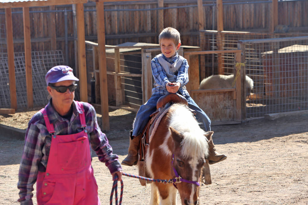 Kathleen Meehan leads a pony ride for Frankie Lorr, 6, at J.R. Pony Farm in Las Vegas, Wednesday, Feb. 28, 2018. The city of Las Vegas wants to annex 872 acres of land that would affect   more tha ...