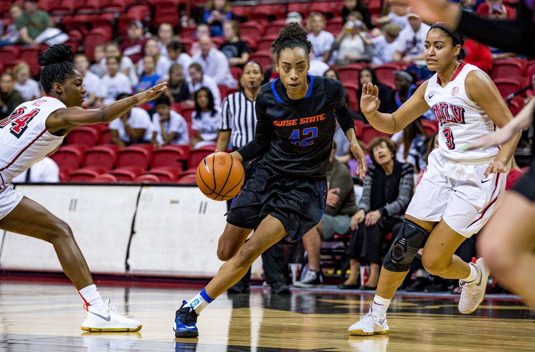 Boise State's A'Shanti Coleman (42) dribbles around UNLV defenders Rodjanae Wade (24) and Paris Strawther (3) try to block her at the Thomas & Mack Center in Las Vegas on Saturday, Feb. 3, 201 ...