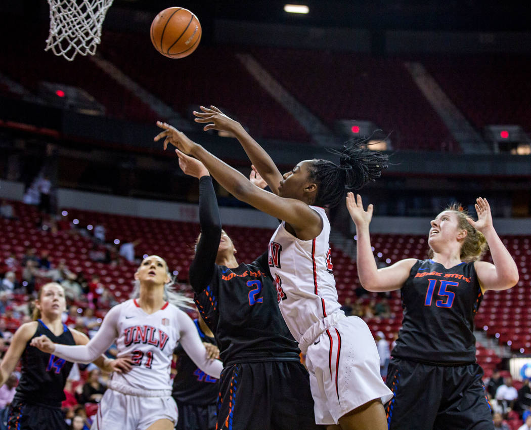 UNLV center Rodjanae Wade (24) lobs the ball toward the hoop while Boise State's Shalen Shaw (2) tries to defend and Tess Amundsen (15) watches from behind at the Thomas & Mack Center in Las V ...