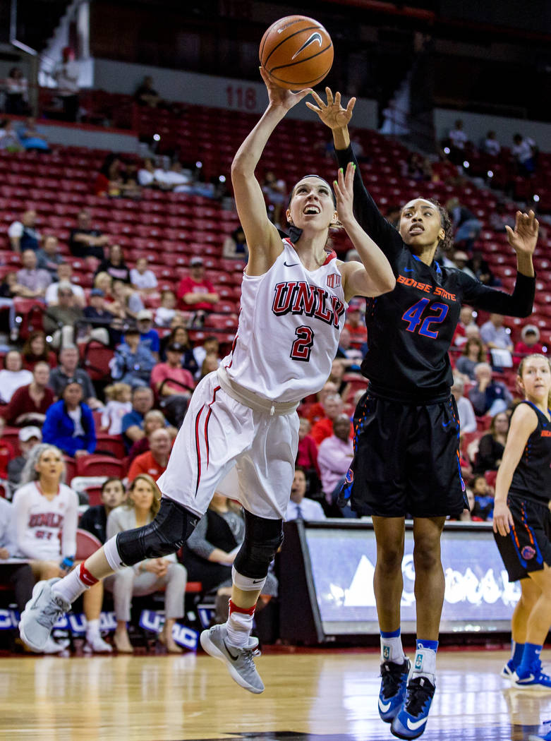 UNLV's Brooke Johnson (2) goes up for a shot while Boise State's A'Shanti Coleman (42) tries to block her at the Thomas & Mack Center in Las Vegas on Saturday, Feb. 3, 2018. UNLV won 77-54.  P ...