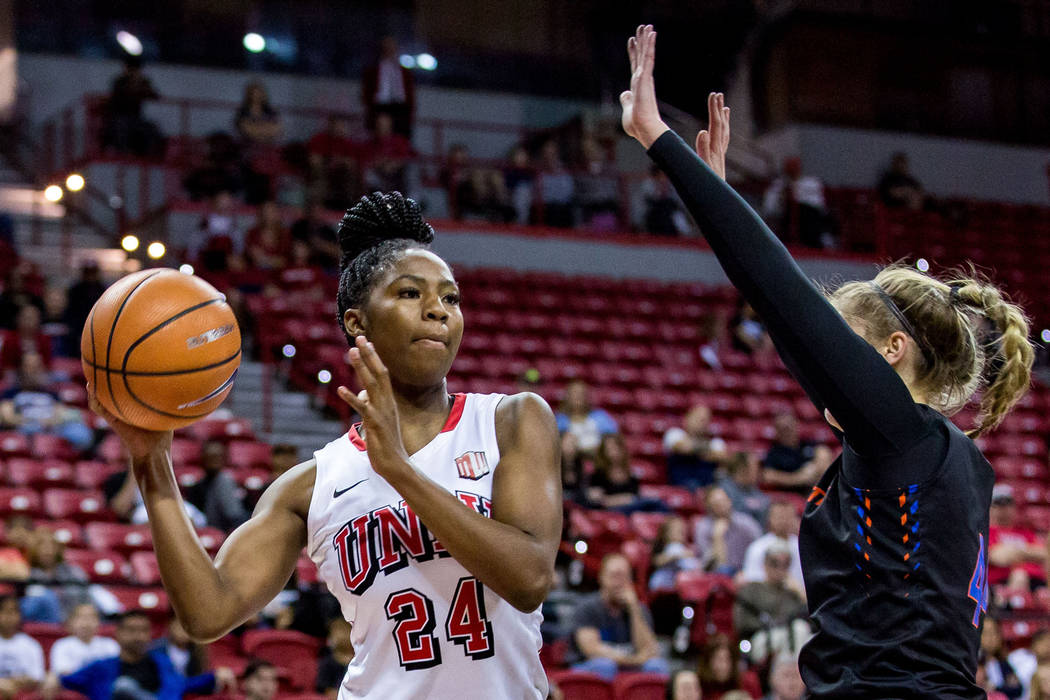 UNLV's Rodjanae Wade (24) looks for a pass while Boise State's Emerald Tooth (44) tries to block at the Thomas & Mack Center in Las Vegas on Saturday, Feb. 3, 2018. UNLV won 77-54.  Patrick Co ...