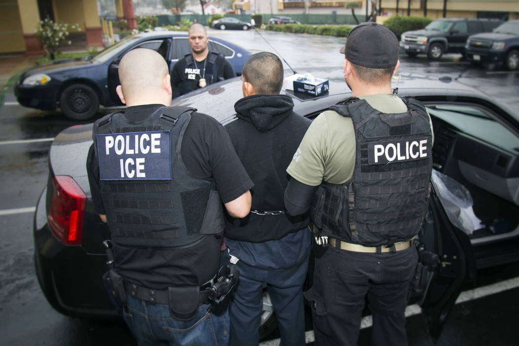 Foreign nationals are arrested during a targeted enforcement operation conducted by ICE aimed at immigration fugitives, re-entrants and at-large criminal aliens in Los Angeles in 2017. (Charles Re ...
