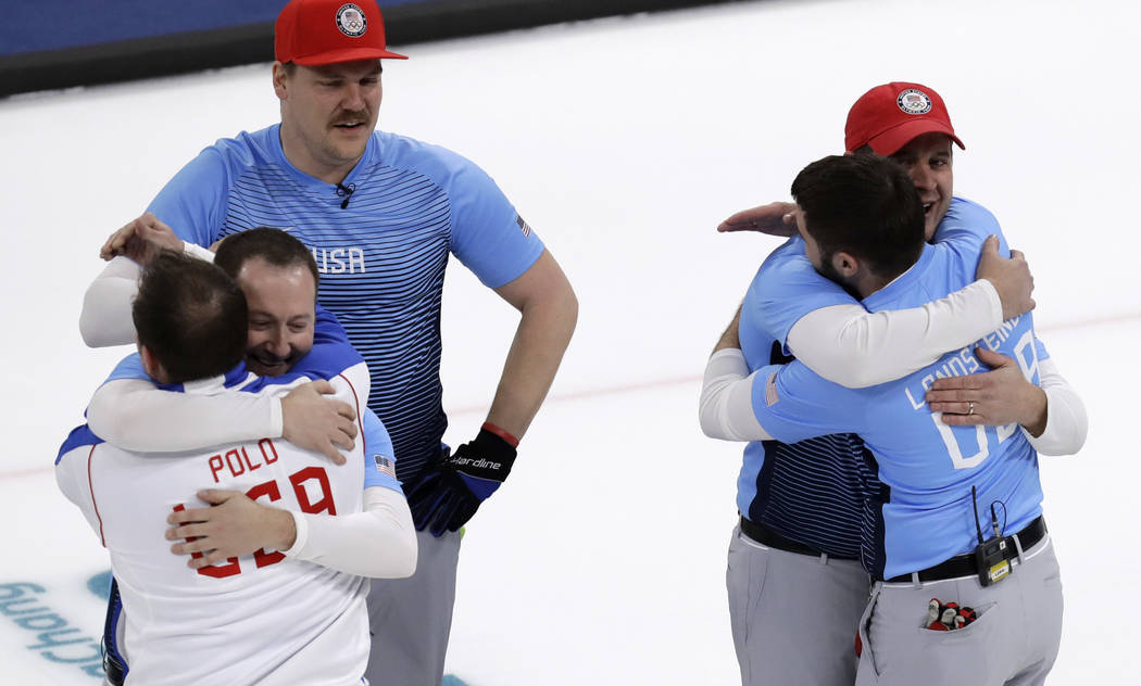 United States team celebrate during the men's curling finals match against Sweden at the 2018 Winter Olympics in Gangneung, South Korea, Saturday, Feb. 24, 2018. United States won gold. (AP Photo/ ...