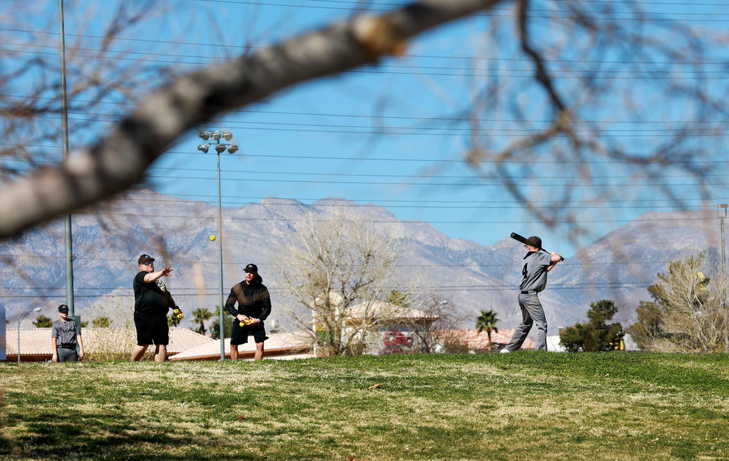 Patrons play baseball at Desert Breeze Park in Las Vegas on Sunday, Feb. 18, 2018. Andrea Cornejo Las Vegas Review-Journal @DreaCornejo