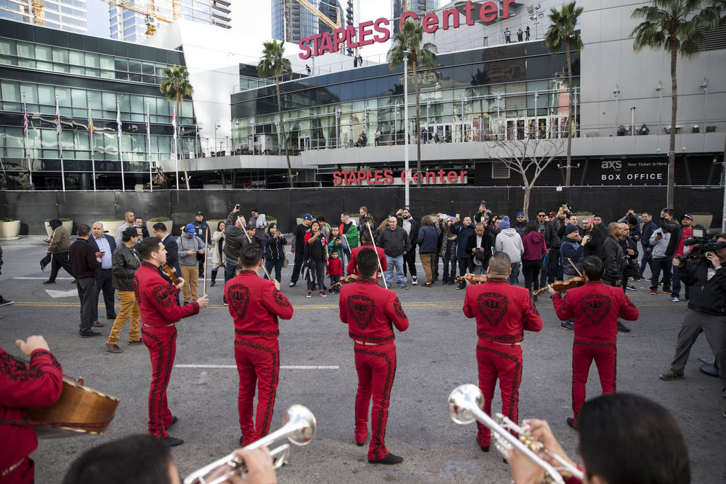 """People watch a mariachi perform during a press conference for the upcoming boxing fight between Gennady Golovkin and Saul """"Canelo"""" Alvarez at Microsoft Square in Los Angeles, Calif., Tue ..."""