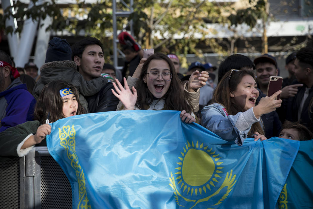 Sagida Aitkhozhina, 13, from left, with her friend Anelya Kutzhan, 13, and Kutzhan's mother Aliya Makasheva, cheer for Gennady Golovkin during a press conference at Microsoft Square in Los Angeles ...