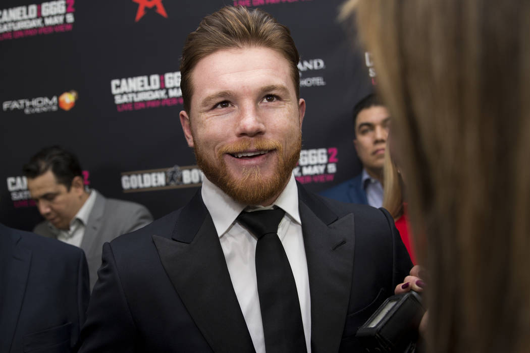 "Saul ""Canelo"" Alvarez, center, is interviewed during a boxing press conference at L.A. Live in Los Angeles, Calif., Tuesday, Feb. 27, 2018. Erik Verduzco Las Vegas Review-Journal @Erik_V ..."