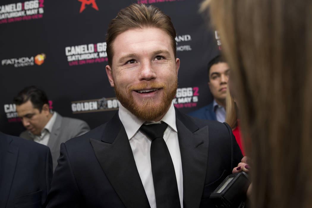 "Saul ""Canelo"" Alvarez, center, is interviewed during a boxing press conference at L.A. Live in Los Angeles, Calif., Tuesday, Feb. 27, 2018. Erik Verduzco Las Vegas Review-Journal @Erik_V ..."