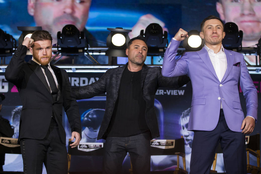 "Boxers Saul ""Canelo"" Alvarez, left, and Gennady Golovkin, right, during their press conference with boxing promoter Oscar De La Hoya, at Microsoft Square in Los Angeles, Calif., Tuesday, ..."