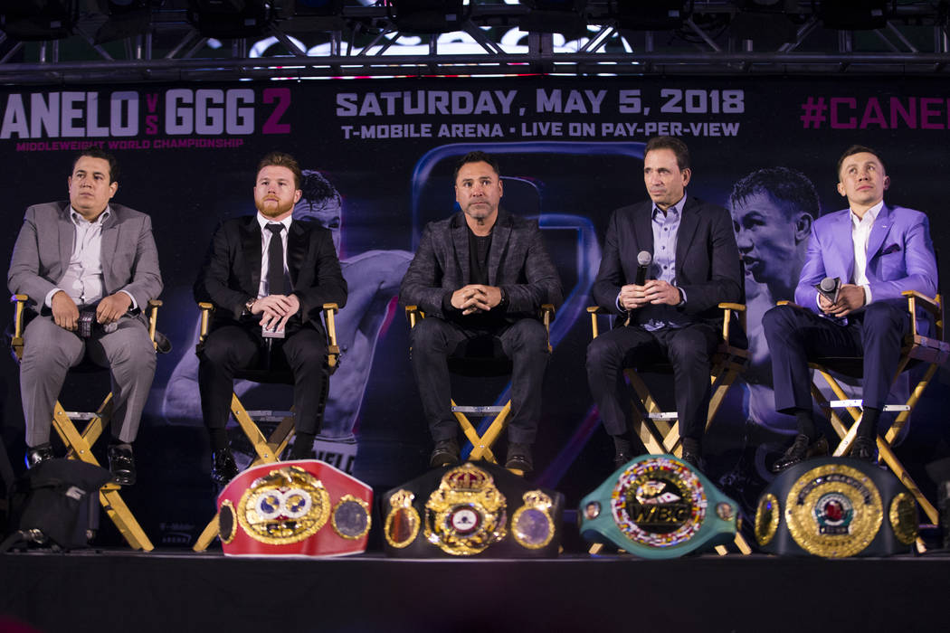 "Boxing trainer Eddy Reynoso, from left, boxer Saul ""Canelo"" Alvarez, promoter Oscar De La Hoya, promoter Tom Loeffler, and boxer Gennady Golovkin, during a press conference at Microsoft  ..."