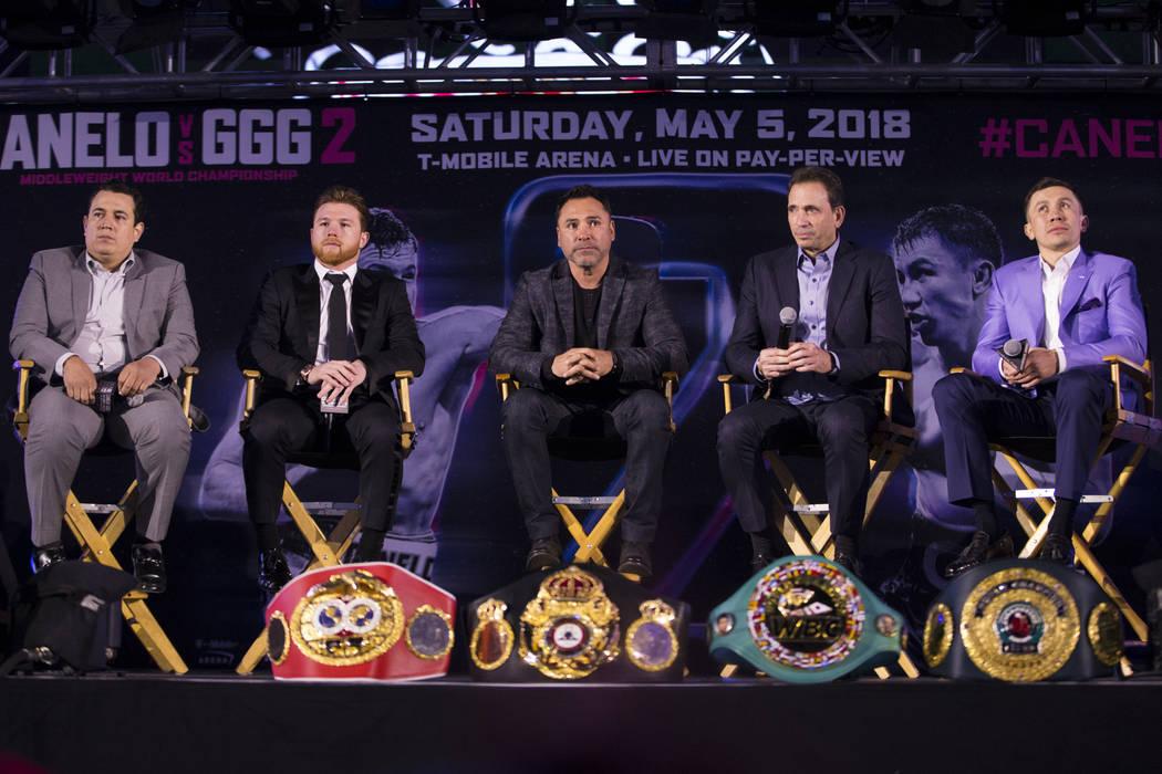 "Boxing trainer Eddy Reynoso, from left, boxer Saul ""Canelo"" Alvarez, promoter Oscar De La Hoya, promoter Tom Loeffler, and boxer Gennady Golovkin, during a press conference at Microsoft  ..."