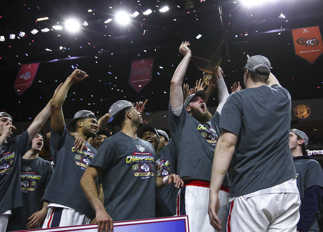 Gonzaga center Przemek Karnowski (24) holds up the trophy while celebrating with teammates after defeating St. Mary's 74-56 in the West Coast Conference basketball championship game at the Orleans ...