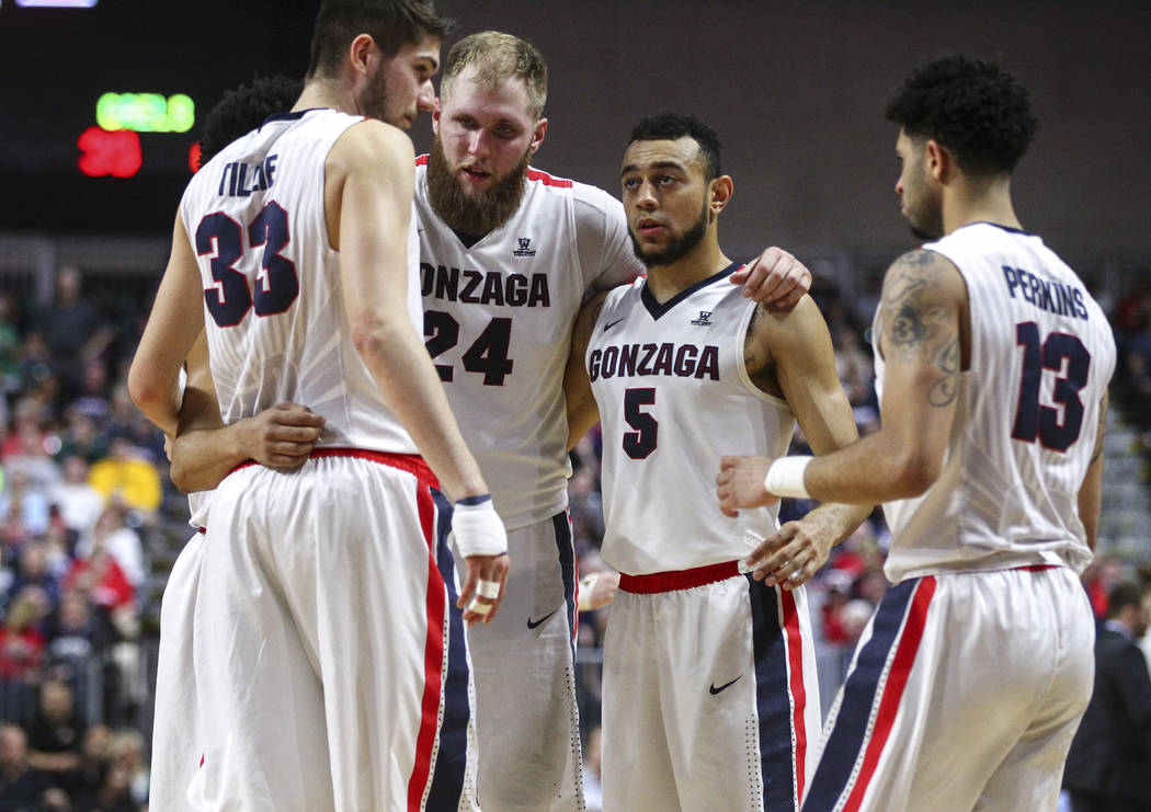 Gonzaga players, from left, Killian Tillie (33), Przemek Karnowski (24), Nigel Williams-Goss (5) and Josh Perkins (13) huddle during the West Coast Conference basketball championship game against  ...
