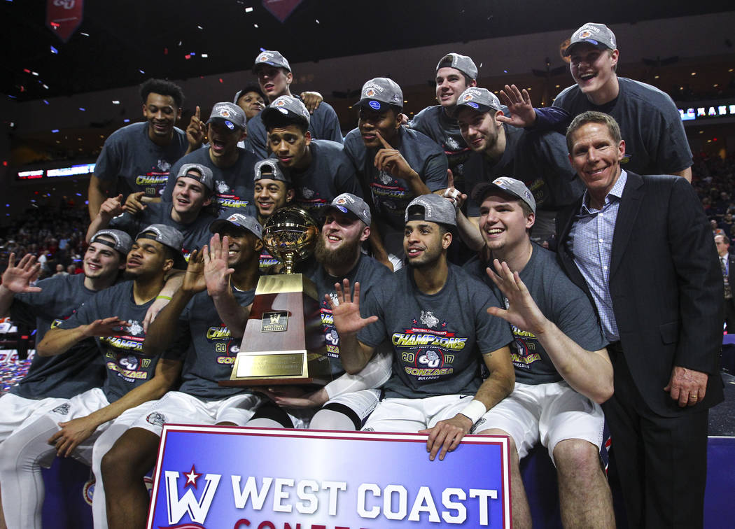 Gonzaga players, along with head coach Mark Few, after defeating St. Mary's 74-56 in the West Coast Conference basketball championship game at the Orleans Arena in Las Vegas on Tuesday, March 7, 2 ...