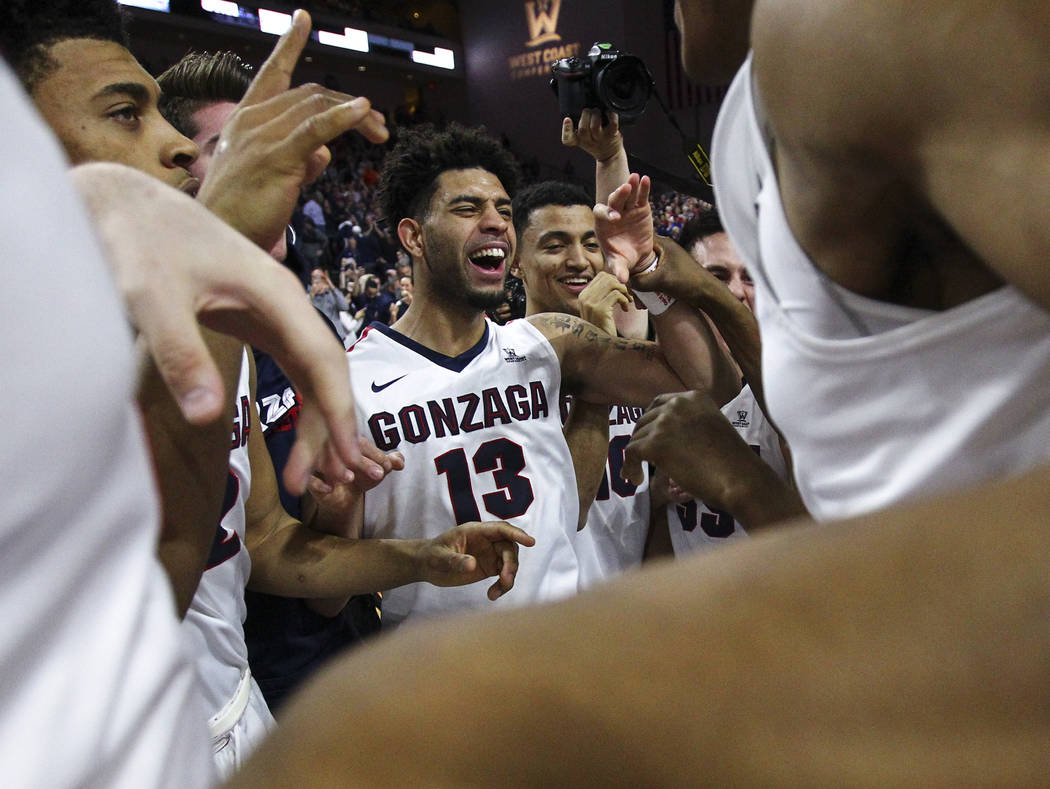 Gonzaga guard Josh Perkins (13) celebrates with teammates after defeating St. Mary's 74-56 in the West Coast Conference basketball championship game at the Orleans Arena in Las Vegas on Tuesday, M ...