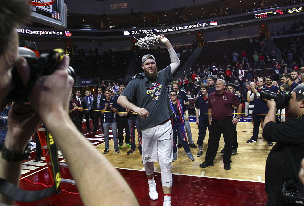Gonzaga center Przemek Karnowski (24) walks with the net after defeating St. Mary's 74-56 in the West Coast Conference basketball championship game at the Orleans Arena in Las Vegas on Tuesday, Ma ...