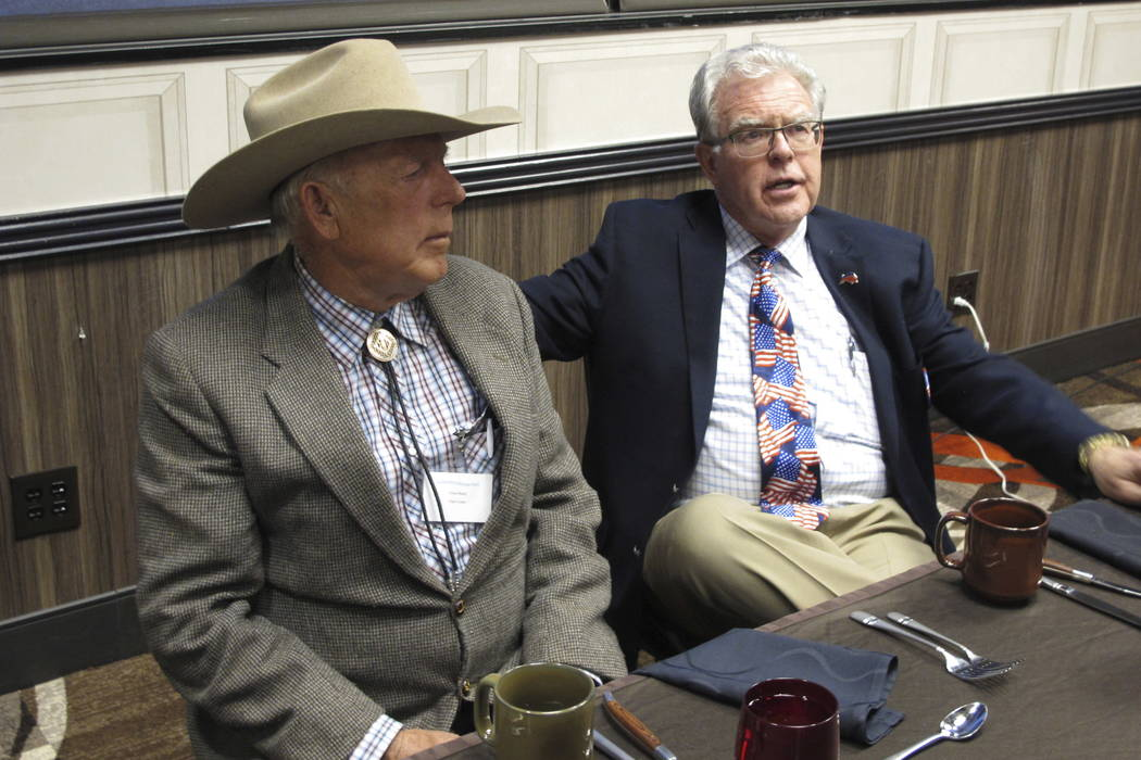 Southern Nevada rancher Cliven Bundy, left, listens to Independent American Party of Nevada Chairman Joel Hansen before Bundy was scheduled to give the keynote address to the third-party's state c ...