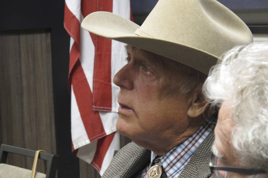 Southern Nevada rancher Cliven Bundy listens to other speakers before giving the keynote address to the state convention of the Independent American Party of Nevada, Friday, Feb. 23, 2018, in Spar ...