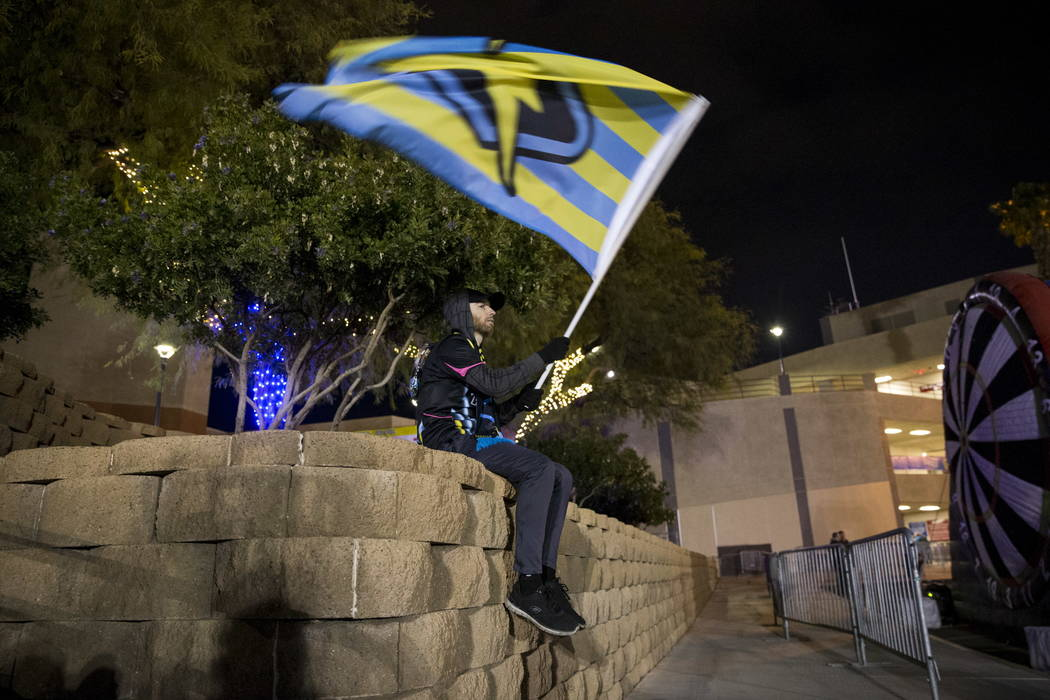 Season ticket holder Matt Helfst of Las Vegas waves his flag outside of Cashman Field before the exhibition soccer game between Las Vegas Lights FC and D.C. United in Las Vegas, Saturday, Feb. 24, ...