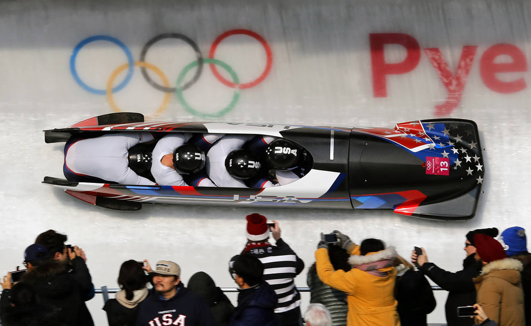Driver Codie Bascue, Steven Langton, Samuel Mc Guffie and Evan Weinstock of the United States take turn 14 during their third heat during the four-man bobsled competition final at the 2018 Winter  ...