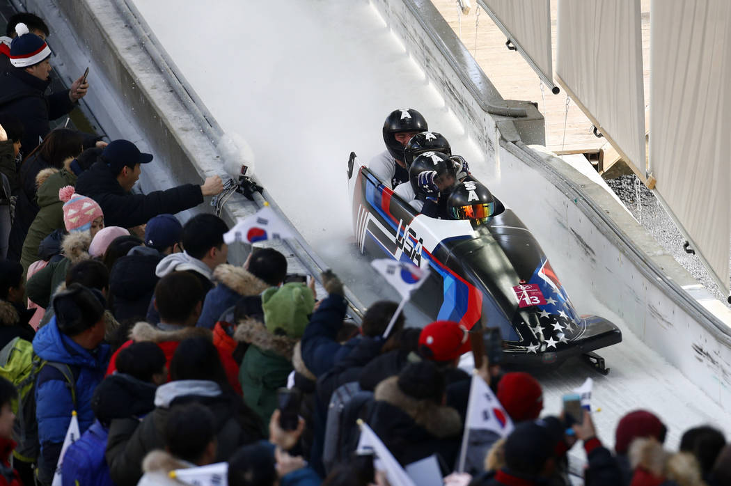 Driver Codie Bascue, Steven Langton, Samuel Mc Guffie and Evan Weinstock of the United States finish their third heat during the four-man bobsled competition final at the 2018 Winter Olympics in P ...