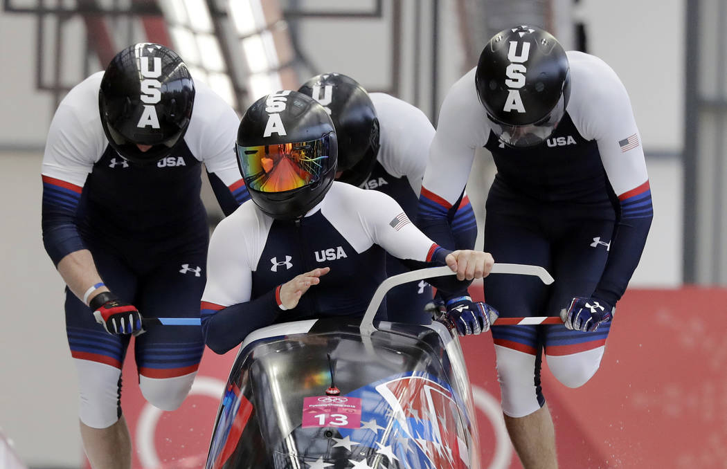 Driver Codie Bascue, Steven Langton, Samuel Mc Guffie and Evan Weinstock of the United States start their third heat during the four-man bobsled competition final at the 2018 Winter Olympics in Py ...