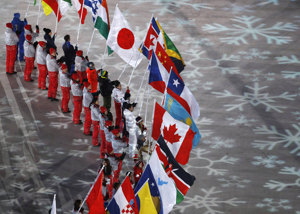 Flag bearers from various nations attend the closing ceremony of the 2018 Winter Olympics in Pyeongchang, South Korea, Sunday, Feb. 25, 2018. (AP Photo/Charlie Riedel)