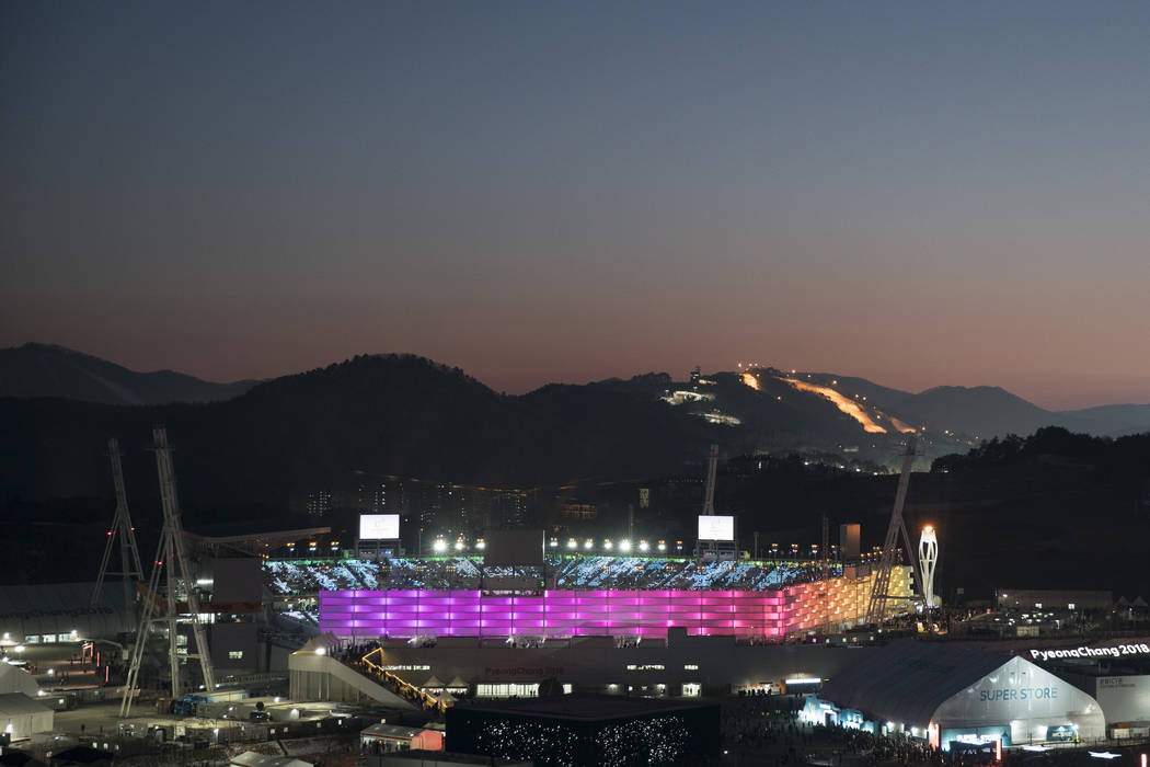 The Olympic Stadium is illuminated prior to the closing ceremony of the 2018 Winter Olympics in Pyeongchang, South Korea, Sunday, Feb. 25, 2018. (AP Photo/Felipe Dana)
