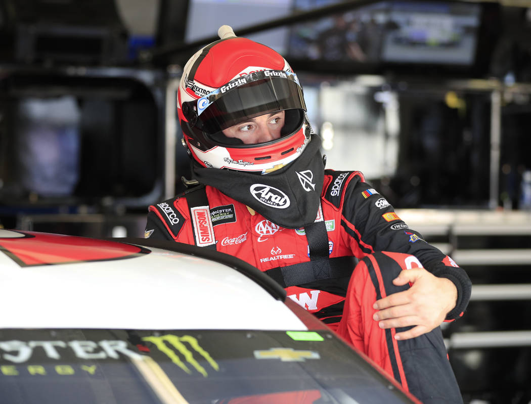 NASCAR Cup Series driver Austin Dillon (3) climbs into his car for practice for Sunday's NSCAR Cup series auto race at Atlanta Motor Speedway in Hampton, Ga., on Saturday, Feb. 24, 2018. (AP Photo ...