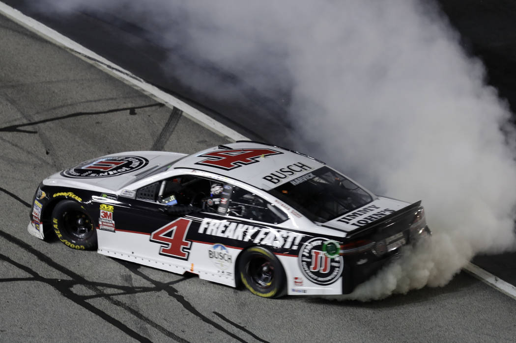 Monster Energy NASCAR Cup Series driver Kevin Harvick (4) does a burnout after winning the NASCAR Cup Series auto race at Atlanta Motor Speedway in Hampton, Ga., on Sunday, Feb. 25, 2018. (AP Phot ...
