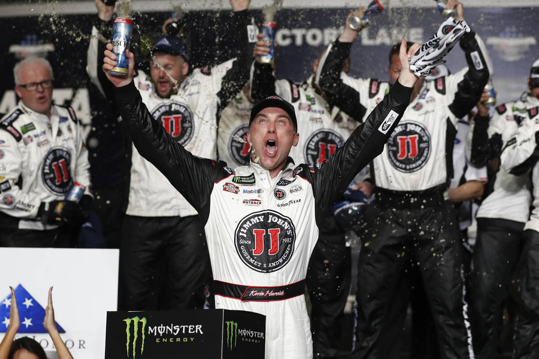 Monster Energy NASCAR Cup Series driver Kevin Harvick (4) reacts after wining the NASCAR Cup Series auto race at Atlanta Motor Speedway in Hampton, Ga., on Sunday, Feb. 25, 2018. (AP Photo/John Ba ...