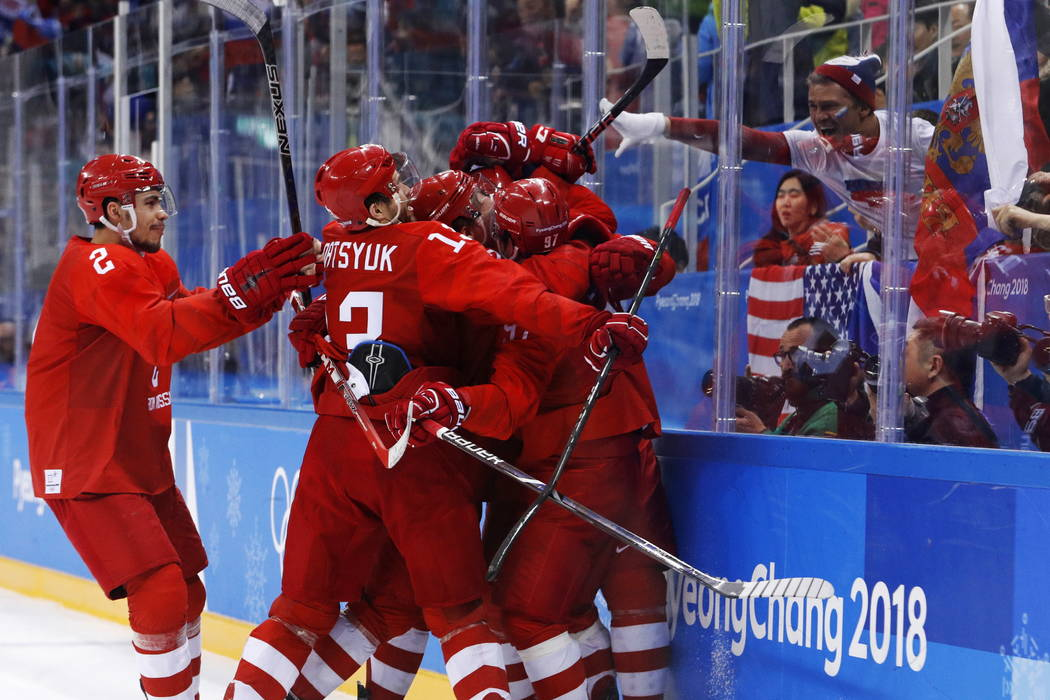 Olympic athletes from Russia celebrate after a goal by Nikita Gusev during the third period of the men's gold medal hockey game against Germany at the 2018 Winter Olympics, Sunday, Feb. 25, 2018,  ...