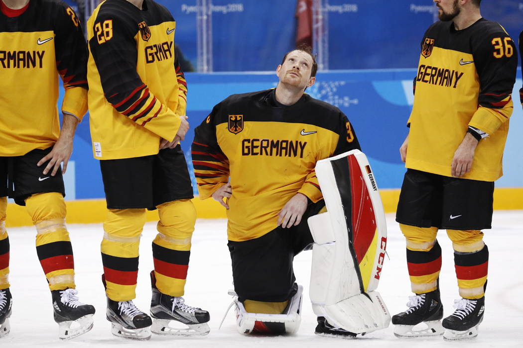 Danny Aus den Birken (33), of Germany, reacts after losing during overtime of the men's gold medal hockey game against the Olympic athletes from Russia, 4-3, at the 2018 Winter Olympics, Sunday, F ...