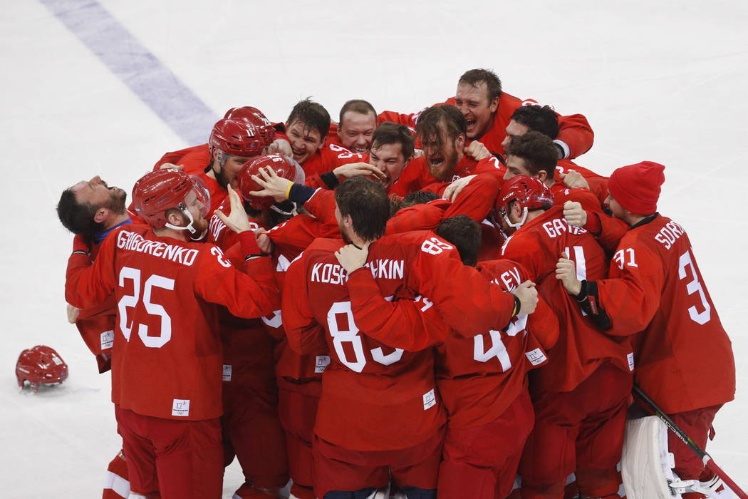 Olympic athletes from Russia celebrate after winning the men's gold medal hockey game against Germany, 4-3, in overtime at the 2018 Winter Olympics, Sunday, Feb. 25, 2018, in Gangneung, South Kore ...