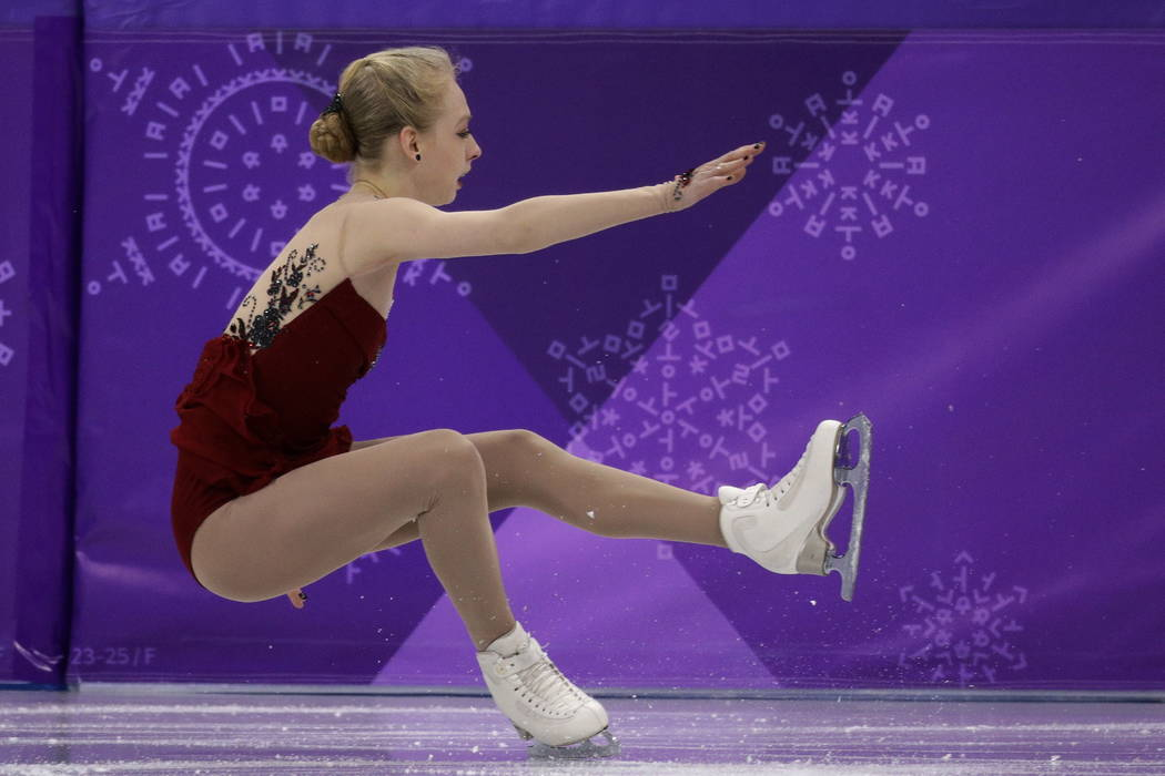 Bradie Tennell, of the United States, falls while performing during the women's short program figure skating in the Gangneung Ice Arena at the 2018 Winter Olympics in Gangneung, South Korea. (AP P ...